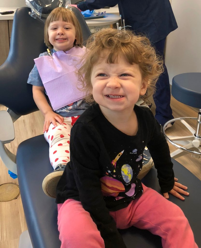 two little girls in dental chair